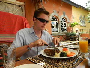 Digging in, at a restaurant outside Nairobi. Photo: Haley Burrowes