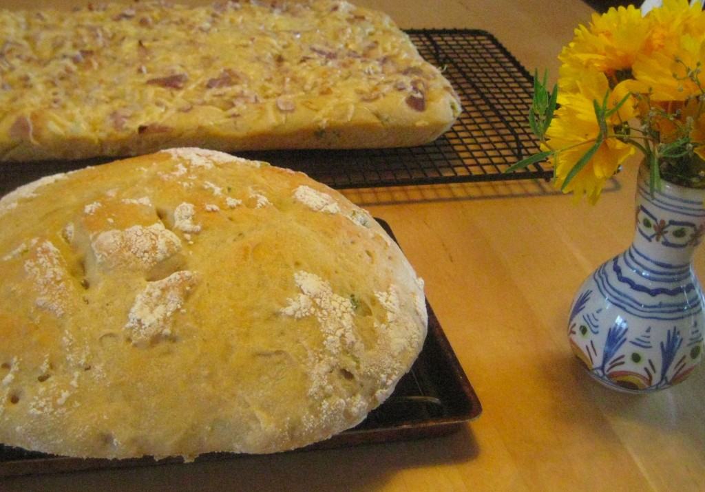 Ready to eat: sourdough focaccia flatbread and jalapeno-studded oval loaf. (photo by Lucy Martin)