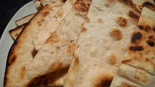 I'm guessing this particular flat bread is from an Eastern or Southern European tradition. Photo: Mirona Liescu, via Creative Commons, some restrictions.