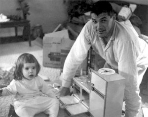 Father and daughter with early Easy Bake Oven, which resembled a conventional oven. Public domain