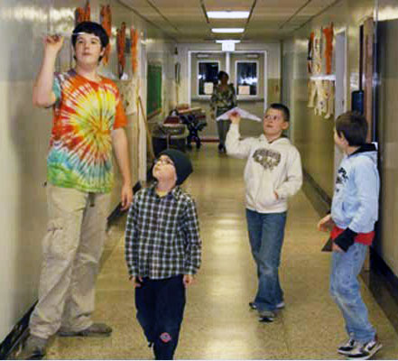 Members of the Indian Lake Central School Paper Airplane Club performing test flights in 2009. Archive Photo of the Day: George DeChant
