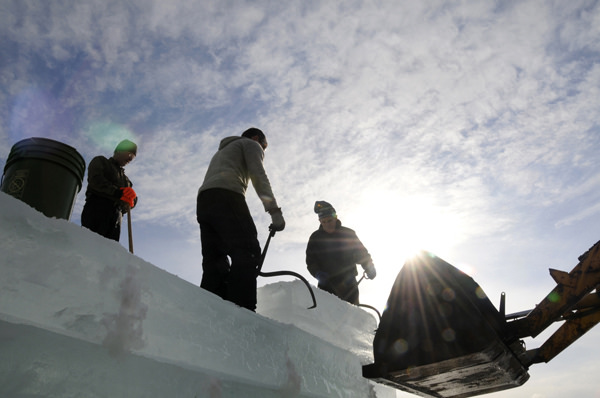Off loading one of the ice blocks high up on one of the towers of the 2014 Saranac Lake Winter Carnival ice palace. Photo: Mark Kurtz, Saranac Lake, NY