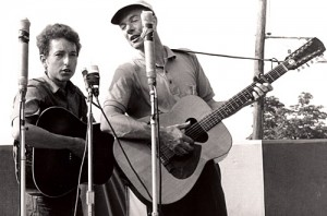 Bob Dylan with Pete Seeger. (Photo via Wikipedia, no licensing.)