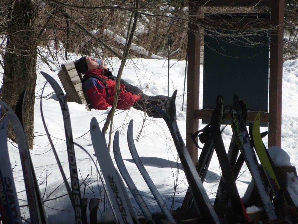 Skiiers take to a bench to soak up late-March sun near Herridge Cabin. Photo: Lucy Martin