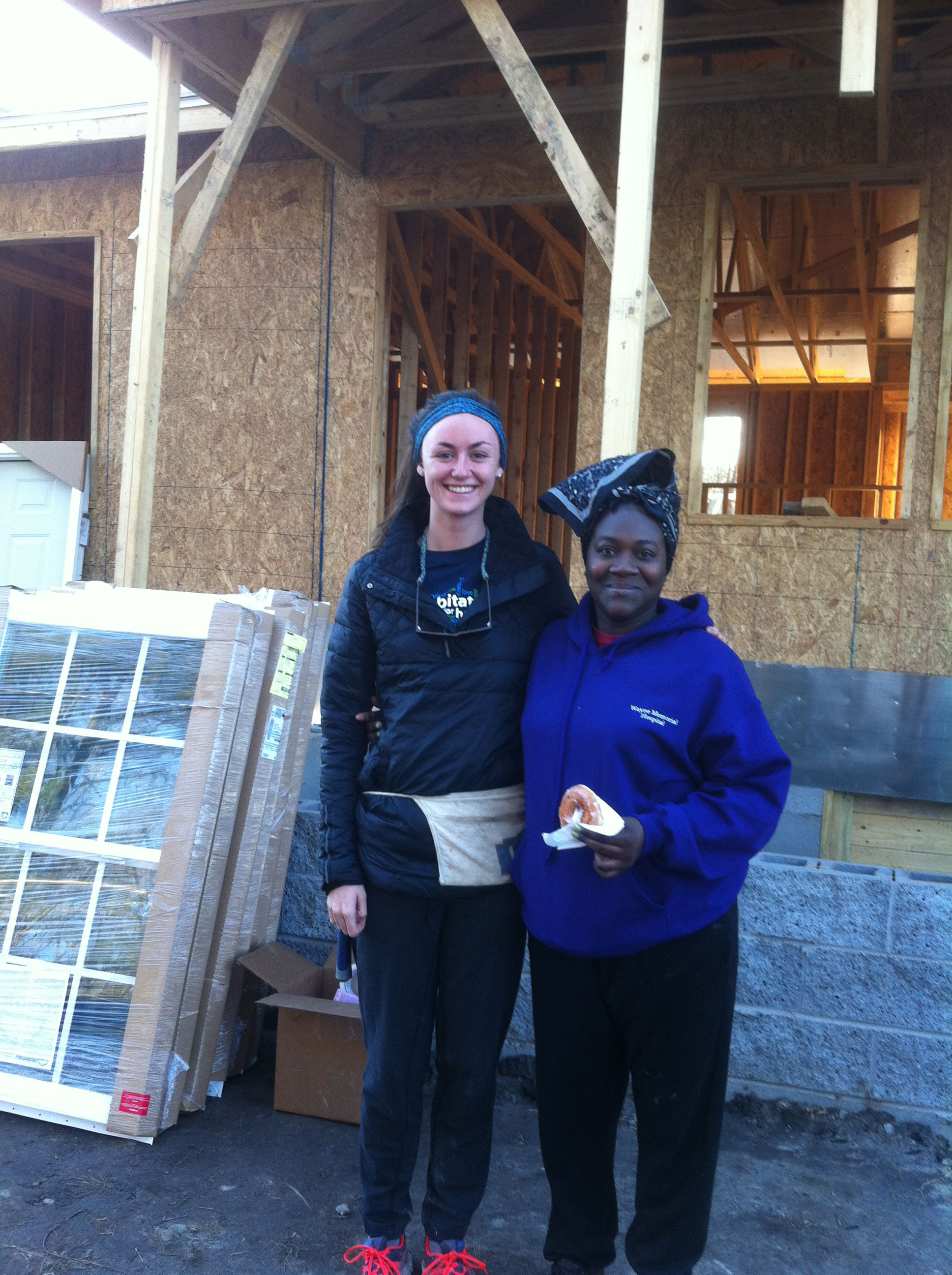Morgan with Takisha, one of the Habitat home owners-to-be. Photo: Ellen Rocco