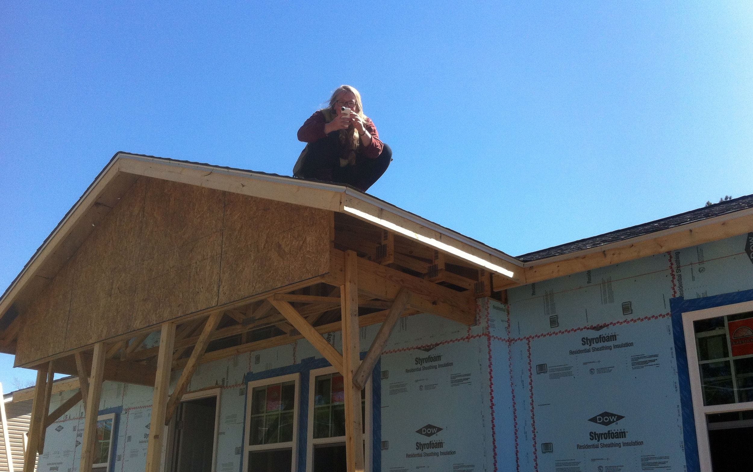 Julie takes a final photo from the finished roof. Note windows and doors. They're installed! Photo: Ellen Rocco
