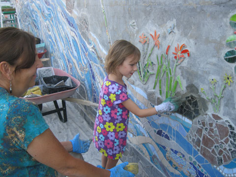 Working on the Main Street mosaic in North Creek. Photo: Ellen Rocco