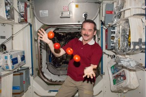 "Chris Hadfield of the Canadian Space Agency juggles some tomatoes, which he probably considers to be among the more delicious components of a recent ""package"" that arrived from Earth on March 3. (2013) Source: NASA"
