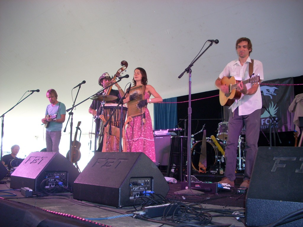 Here's Elephant Revival, also packing 'em in the dance tent.  Their set was great - and Bonnie Paine - the woman in the pink dress - played the washboard in special 'washboard gloves', while playing percussion with her feet (on a stomp board).  Listen to String Fever to hear some of their music!