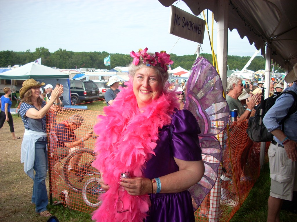 Meet the glitter fairy!  She sprinkles almost everyone with 'fairy dust'.  If she gets you, you'll glitter all night.  She's one of many roving artists and characters at this festival - there's never a dull moment!