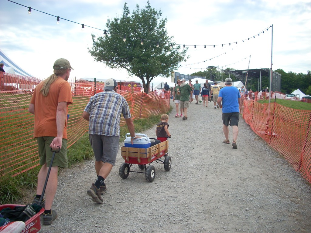 There's a lot of walking at this festival, but so many nice people to meet along the way!  This family is getting ready for a full night of music under the stars... but first, the long haul from the parking field to the big stage.  Everybody helps.....