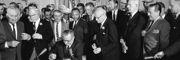 President Lyndon Baines Johnson signs Civil Rights Bill, July 2, 2014. Photo via the LBJ Library.