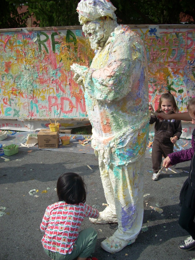 ... and how colorful he is after being 'painted' by so many kids.  I would not want to drive home in that outfit!