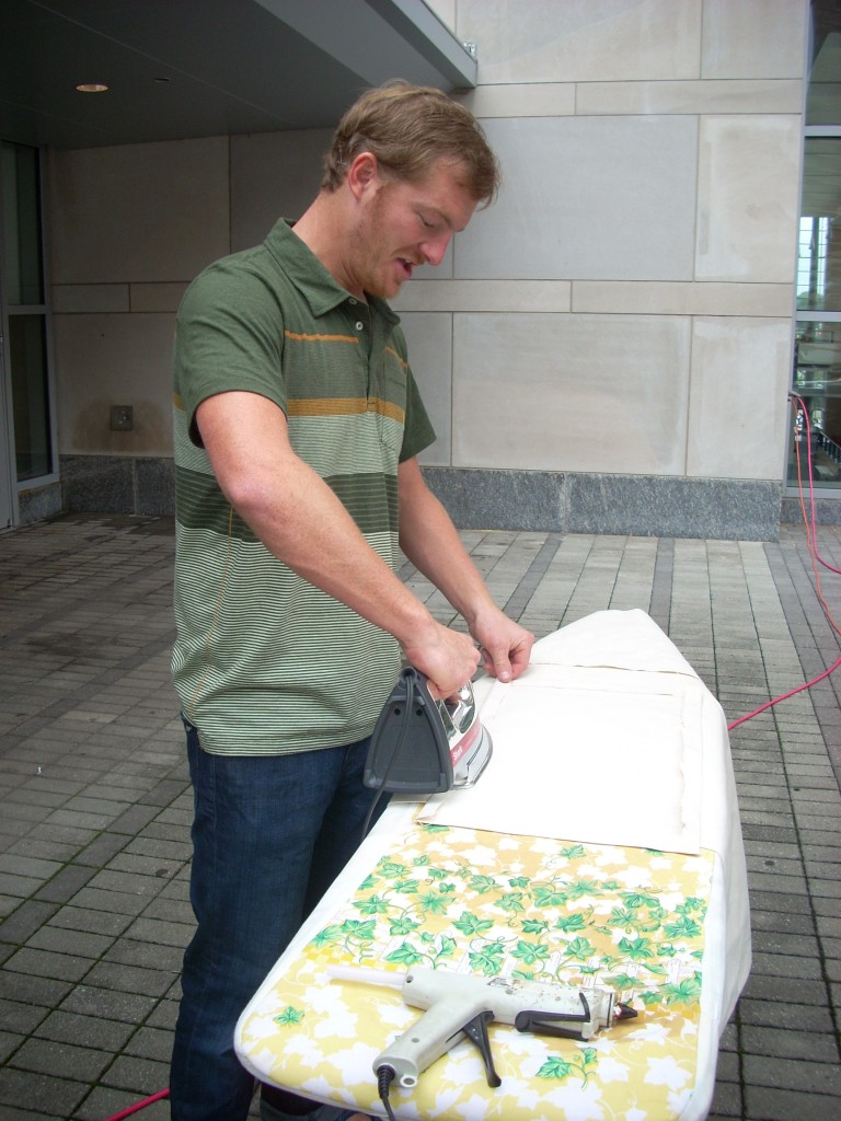 When I walked by, Bland Hoke was hand ironing the canvas skirting for the base of the statue.