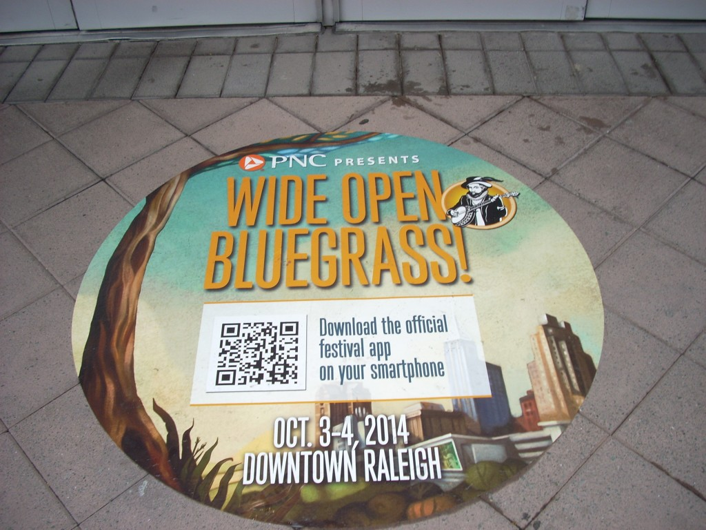 """The city of Raleigh has made a huge effort to make bluegrass visitors feel welcome in """"The City of Oaks"""".  These decals are strategically placed on the sidewalks in the downtown area, and there's bluegrass music playing from public speakers in  City Center."""