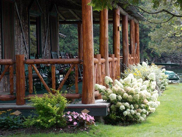 Beautiful, elegant porch garden at The Hedges, Blue Mountain Lake. Photo: Jim and Virginia Jennings