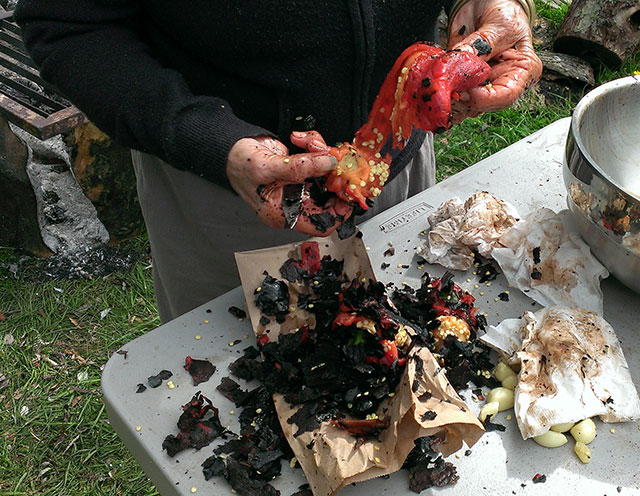 It gets pretty messy skinning charred peppers. Photo: Mary McCallion