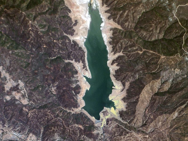 Indian Valley Reservoir, California USA - Planet Labs satellite image. The effects of California's drought become quite apparent in this image of a reservoir in Lake County, which supplies water to nearby Yolo County. In a non-drought year the visible water covers roughly twice the area, and contains ten times the volume.