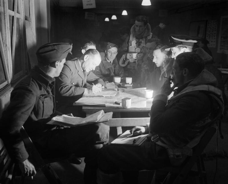 Post-mission debriefing. Photo: A. Goodchild, UK Royal Air Force photographer