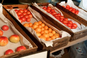 Ripening tomatoes on a tray out of direct sunlight is a better method. Better still would be to wrap them in newsprint. Photo: Dwight Sipler, Creative Commons, some rights reserved