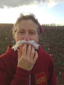 Betsy stands in a cotton field with her cotton boll mustache.