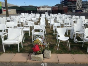 Empty chairs commemorate those killed in quake. Photo: Tom Vandewater