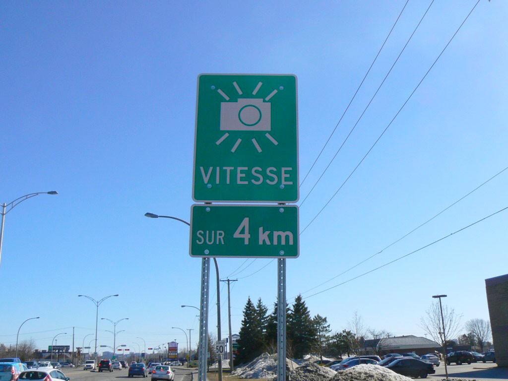 Curbside Kodak: A sign marks the beginning of a four kilometre photo radar zone on Greber Boulevard in Gatineau, Quebec. Photo by James Morgan