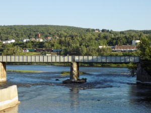 The Madawaska River flows into the St. John River in Edmundston, New Brunswick.  The town in the background is Madawaska, Maine.  Photo by James Morgan