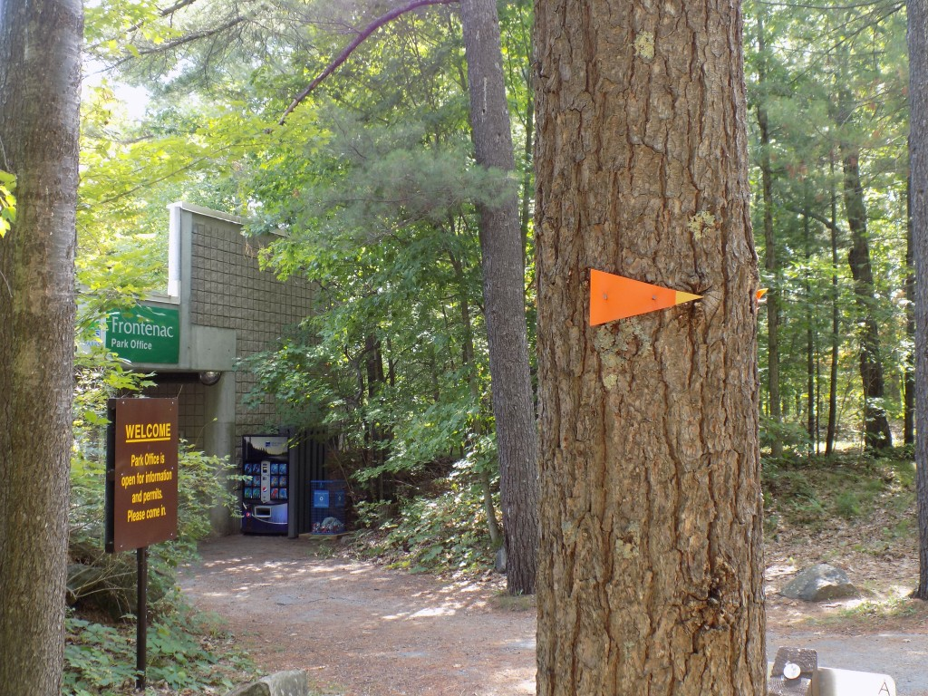 In addition to the many park trails, the 240 mile/387 kilometer Rideau Trail goes through Frontenac Provincial Park on its route from Kingston to Ottawa.  The orange triangle marker shows the way past the park office and visitor center.  Photo by James Morgan