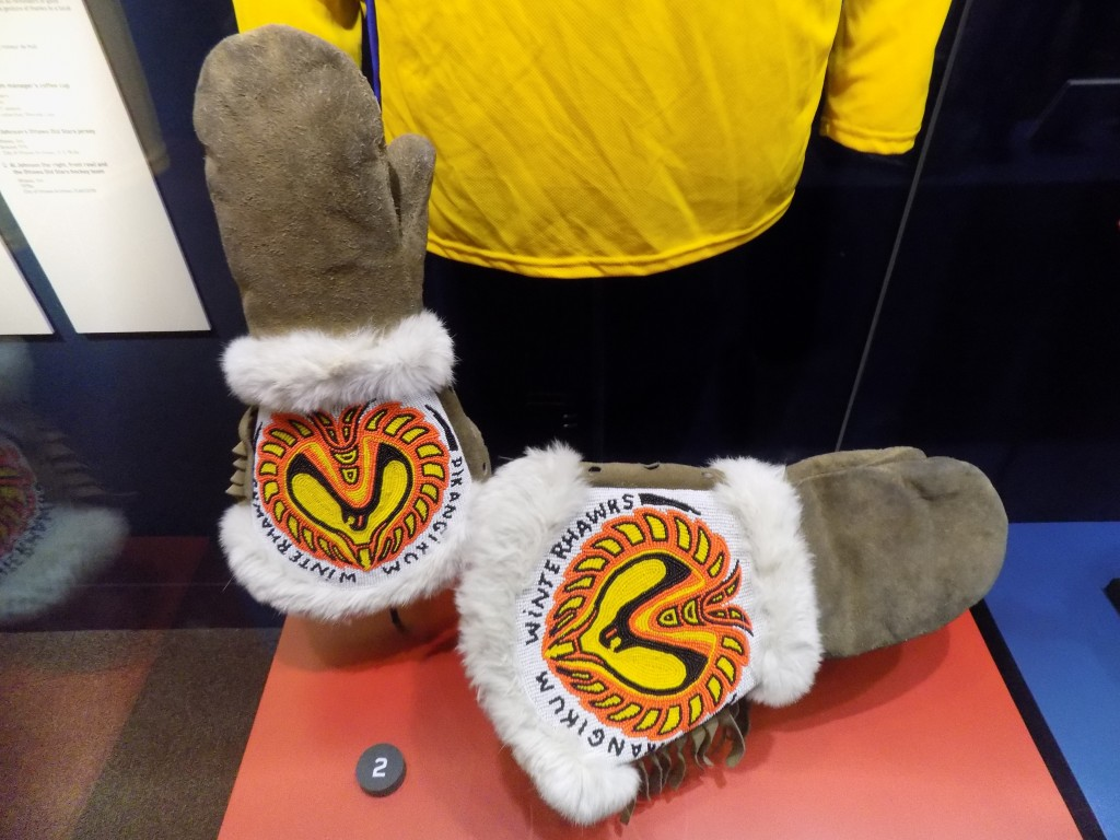 Hockey is popular in Canada's indigenous communities.  These handmade mittens with beadwork of the local team's logo are from the isolated Ojibwe community of Pikangikum in Northern Ontario.  Photo: James Morgan
