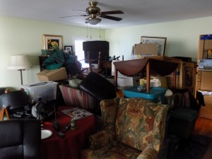 When the basement flooded, John Savage moved everything upstairs and stacked it in the living room.  Photo: James Morgan