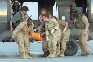 Special Forces soldier Christopher Speer being unloaded at Bagram Airbase after sustaining head injuries from a grenade thrown during the firefight in which Khadr was wounded and captured. Speer later died of his injuries. Photo: U.S. Dept. of Defense