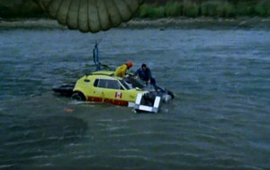 "Kenny Powers being fished out the river after the failed jump. Video still: ""The Devil at Your Heels,"" NFB via Youtube"