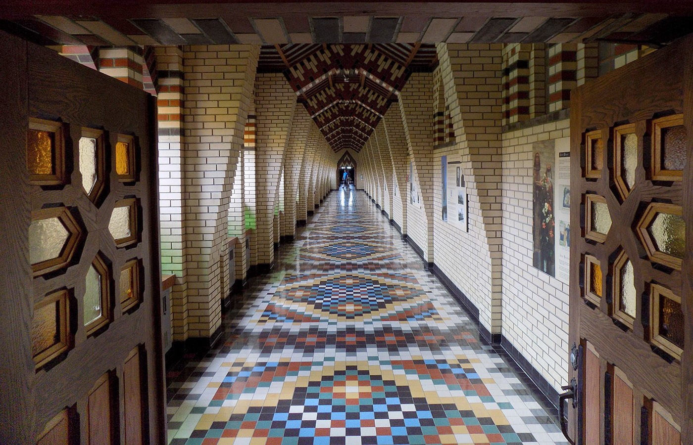 The abbey's main corridor features patterns of brick and tile. Photo: James Morgan