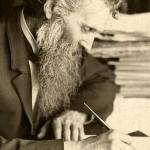 John Muir writing at his desk. Photo: National Park Service