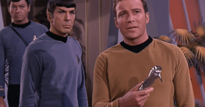 Captain Kirk wields the Universal Translator.