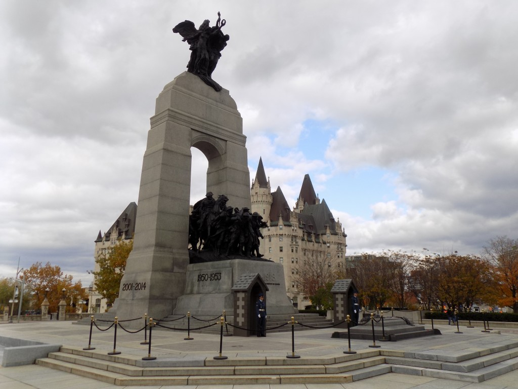 The National War Memorial in Confederation Square in Ottawa.  It was designed by Vernon March and dedicated by King George VI in 1939.  The monument features the dates of all major conflicts Canadians have fought in and the Tomb of the Unknown soldier is located at the front of the monument.  Aviators from the Royal Canadian Air Force were standing guard when this photo was taken.  Photo: James Morgan