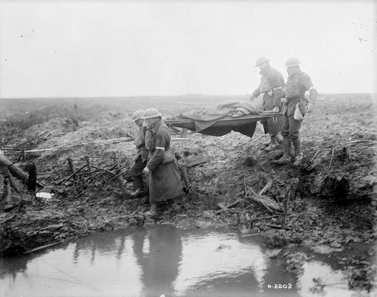 Wounded Canadians on the way to an aid post during the Battle of Passchendaele in 1917.  Library and Archives Canada, MIKAN# 3194341.