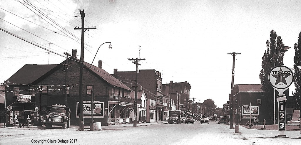 The business section of Morrisburg, Ontario in the 1950s before flooding from the seaway.  This photo was taken looking east on Highway 2.  The intersection with Highway 31 is at the left.  The village war memorial is located on the right.  The Texaco station on the right was owned by Arthur Edgerton.  Photo: The Rev. George H. Smith, Copyright held by Claire Delage.  Photo used by permission from John Gleed.