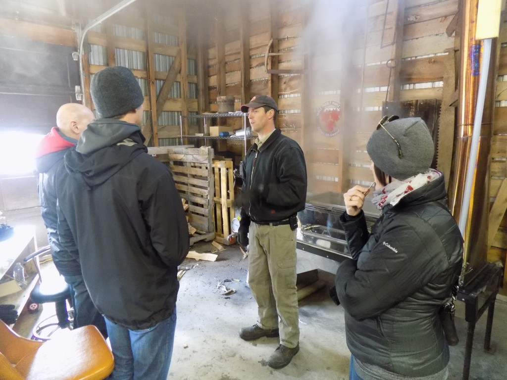 Scott Deugo (middle) talks with visitors to Fulton's on Ontario Maple Weekend.  Photo: James Morgan