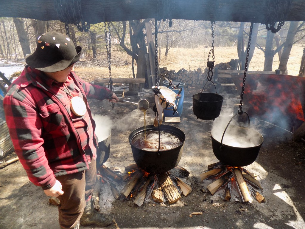 Nathan DePater, one of the Kettle Boys, shows how maple syrup was made over 200 years ago.  Photo: James Morgan