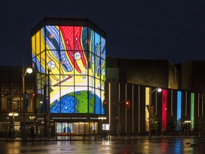 "The work of Ontario Aboriginal Arts Laureate Christi Belcourt featured on the National Arts Centre's three-story LED ""lantern"" in Ottawa as part of the Summer Solstice Indigenous Festival. Promotional photo: NAC"