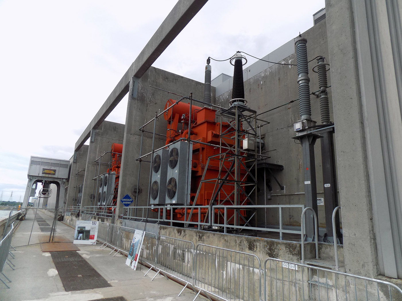 These giant transformers send the electricity generated at the St. Lawrence project into the power grid. The transformers on the Ontario side of the dam are orange. They're gray on the New York side. Photo: James Morgan