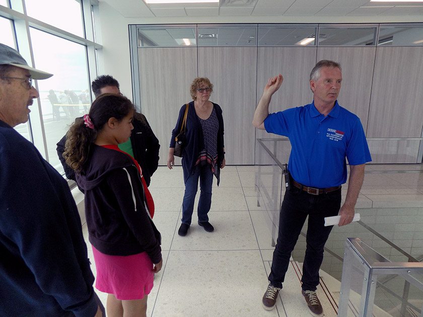 Plant Manager Brent Stajkowski leading a tour on the upper level of the station. Photo: James Morgan