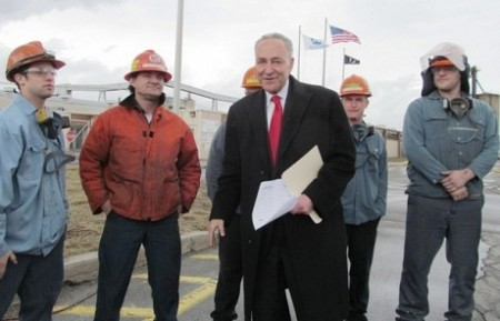 U.S. Sen. Charles Schumer with Alcoa workers in Massena in April, 2013. Photo: Julie Grant