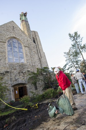 SLU's Dan Seaman helps remove debris from the fallen steeple Monday morning. Photo: Tara Freeman/SLU