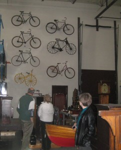 Bikes climb the wall above clocks and boats at the storage facility of the Canadian Museum of Science and Technology