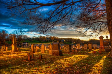 Sunset in the graveyard on Halloween. Photo: Jim Pennucci, Ceative Commons, some rights reserved