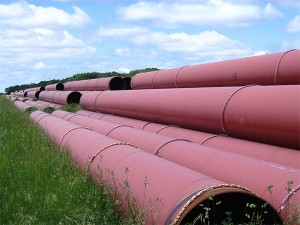 Oil pipeline sections stacked outside Morden, Manitoba. Photo: Loozrboy, Creative Commons, some rights reserved