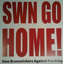 Anti-fracking protest sign. Demonstrations against shale gas development by SWM Resources have taken a violent turn in Rexton, New Brunswick today.